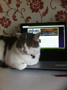 freddie next to computer