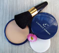 a powder compact and make-up brush