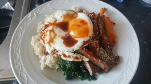 bibimbap - rice, beef, veggies and a fried egg